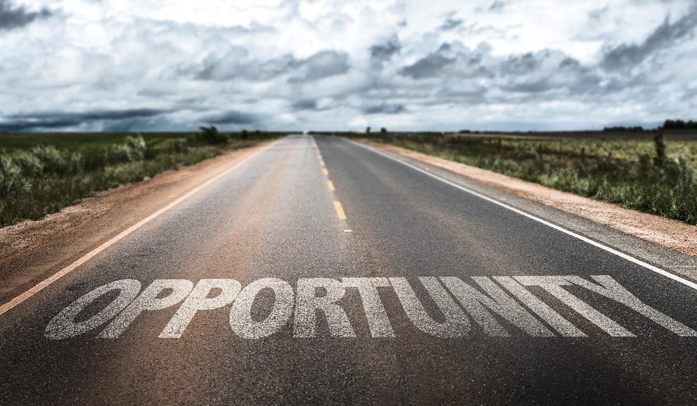 Opportunity written on rural road